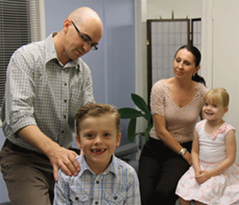Our Warner chiropractor Dr Malone in a family consultation